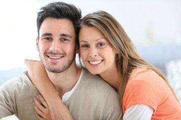 young couple hugging l dental fillings clintonville