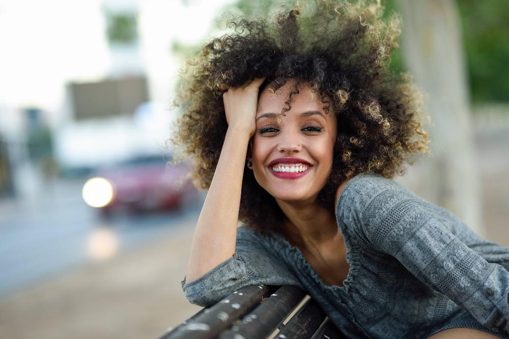 woman with curly hair smiling l invisalign columbus oh